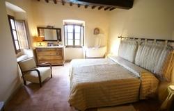 slaapkamer Casa Monterchi in Toscane